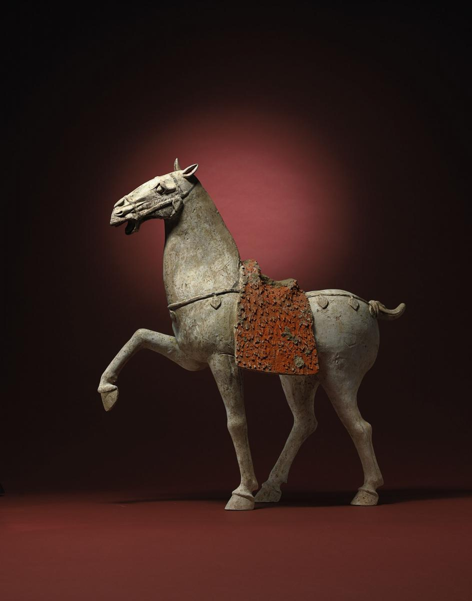 A Fine Chinese Terracotta Model of a Prancing Horse Tang Dynasty
