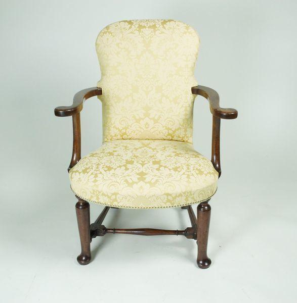 George II Walnut upholstered Arm Chair