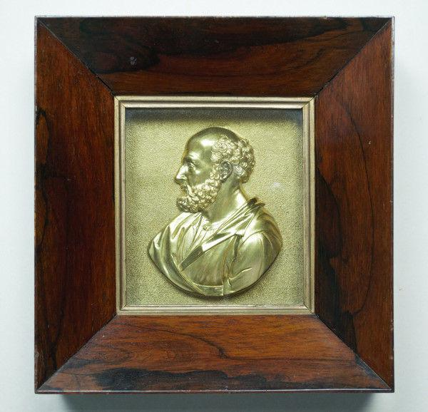 Pair of gilded bronze profile bust portraits