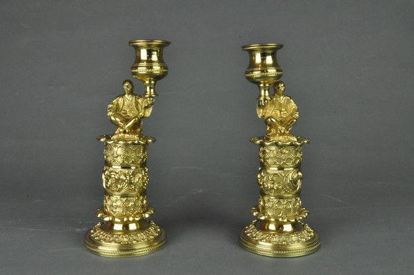 Pair of gilt brass candlesticks of seated Chinamen