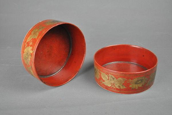 Pair of red lacquer papier mâché coasters