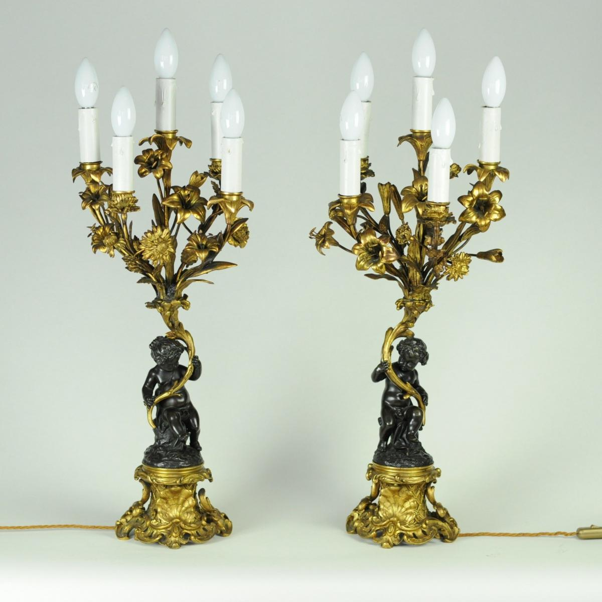 Pair of bronze and ormolu Cherub candelabra