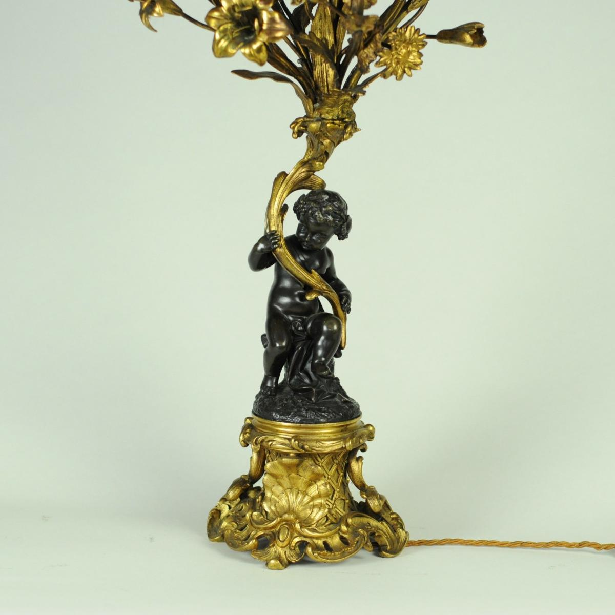 Pair of bronze and ormolu Cherub candelabra
