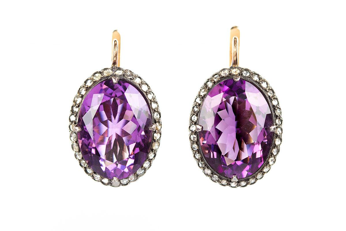 12.	A finely coloured pair of 19th century amethyst earrings, with a surround of rose-cut diamonds. Russian c.1870.