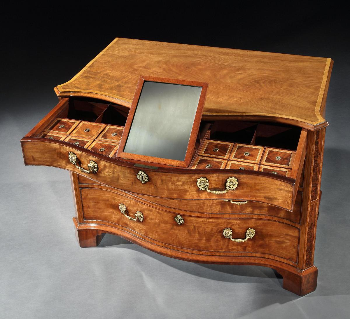A George III Mahogany Chest of Drawers in the manner of Thomas Chippendale