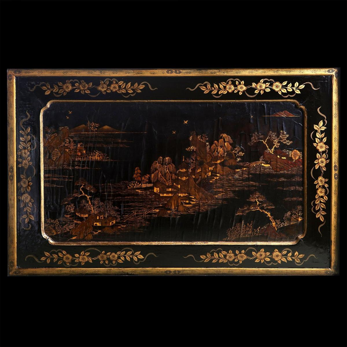 A low table with a 19th century Chinese lacquer panel