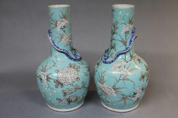 A pair of 19th century chinese pale blue vases