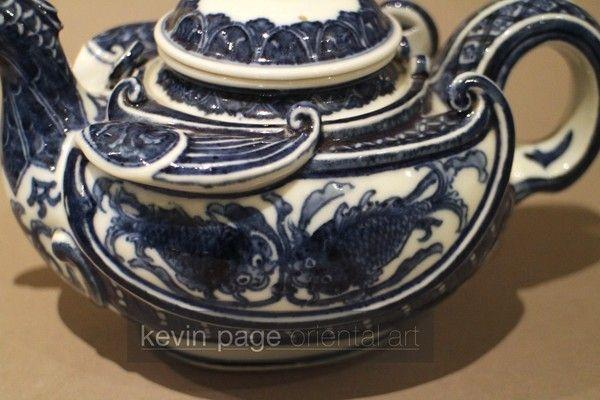 A small blue and white Japanese teapot in the form of a chicken