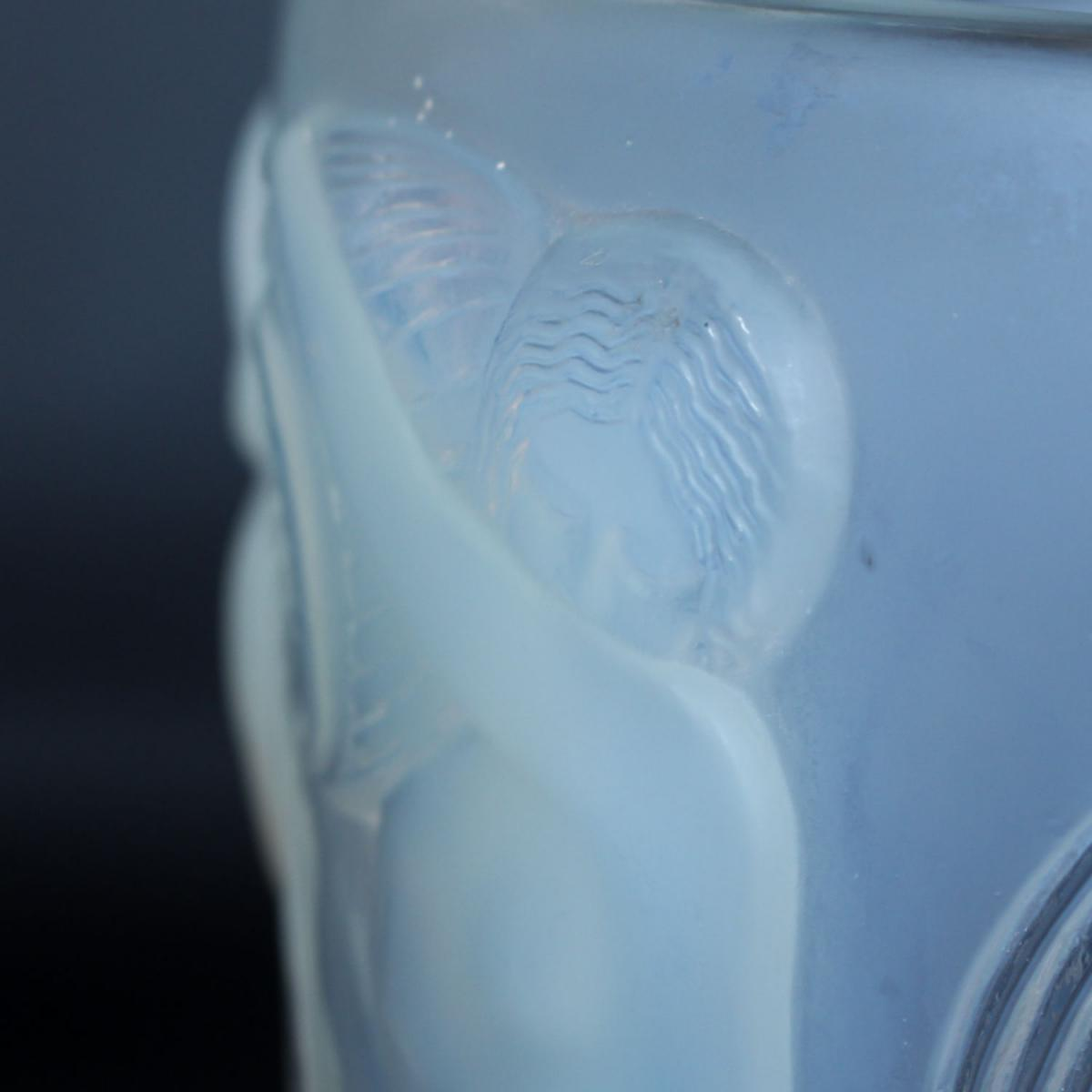 'Danaides', an Art Deco frosted, opalescent glass vase by René Lalique (1860-1945). Decorated over with raised figures of daught
