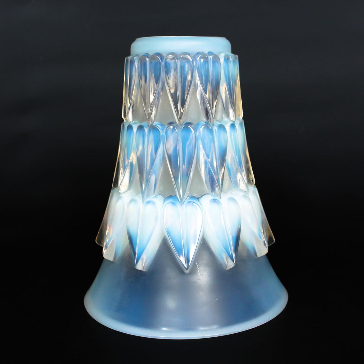 Feuilles, an Art Deco opalescent and moulded glass vase byRené Lalique. Relief decorated with raised hearts.  Stencil etchedR
