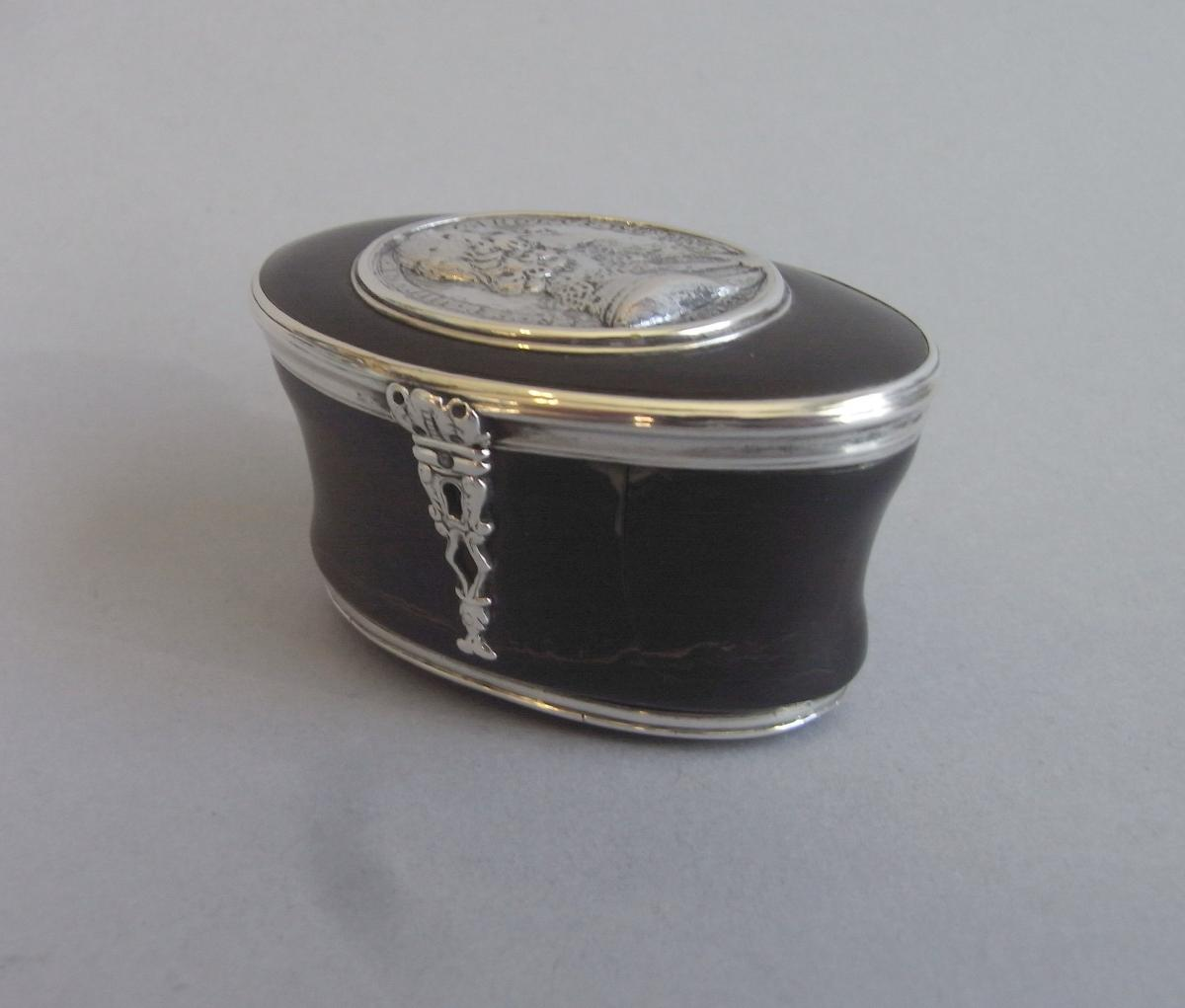 An important William III silver mounted Tortoiseshell Commemorative Standing Snuff Canister, inset with a cast Commonwealth Roya