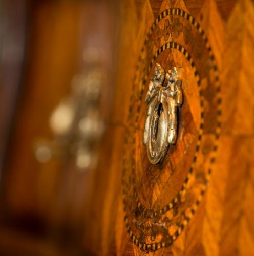 Detail of an antique furniture regency cabinet