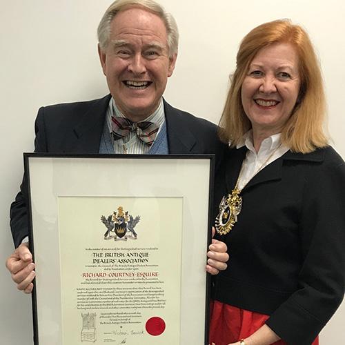 Richard Courtney recieves the BADA distinguished service award from BADA President Victoria Borwick