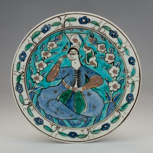 Iznik dish with a figure of a woman, first half of the 17th century, Turkey