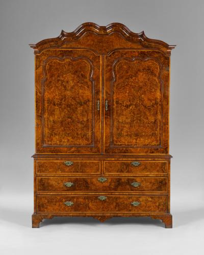 An exceptional George I period burr walnut clothes press or wardrobe with herringbone