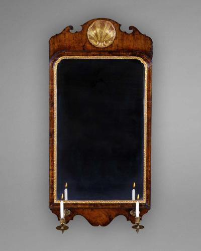 A GEORGE I WALNUT AND GILDED MIRROR