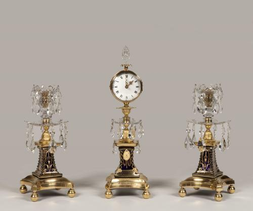 A George III Ormolu 'Candlestick Clock' with Matching Candelabra Attributed to William Parker