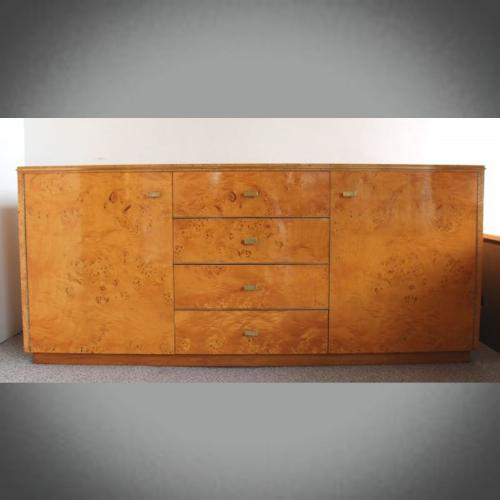 A 20thC sideboard with drawers.