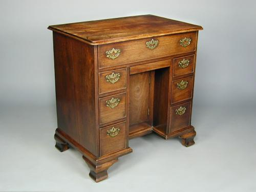 George II mahogany kneehole desk with original handles and feet and of excellent colour