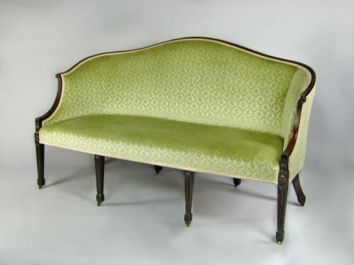 An elegant Hepplewhite period three seater settee with a carved and reeded show-wood frame, c.1790
