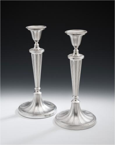 a pair of george iii antique sterling silver candlesticks made in sheffield in 1790 by tudor and leader