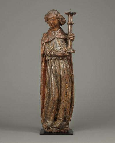 Angel Holding Candlestick  Oak, with original polychrome and traces of gilding England, c. 1420