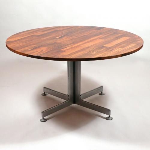 Mid-century modernism: rosewood veneered round dining table.