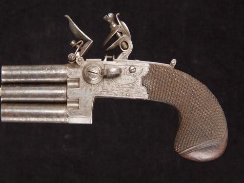 A rare Flintlock Pocket Pistol with three barrels in line