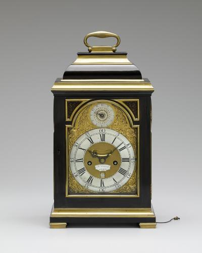 John Everell, London A fine Geo III brass bound ebony veneered table clock of small size