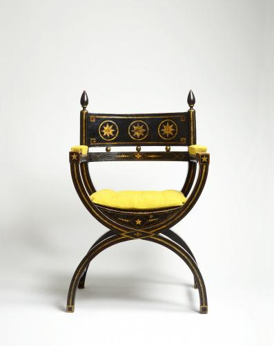 An impressive ebonised and gilt decorated Regency Period x-framed armchair  English, 1810
