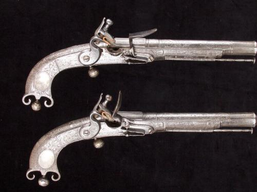 A fine pair of Scottish flintlock steel Doune pistols, signed Jo Murdoch