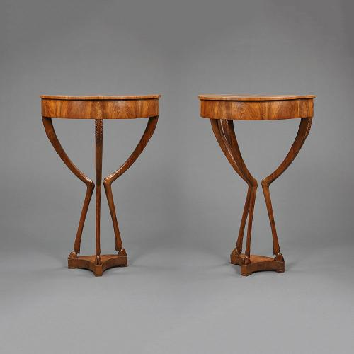 A pair of unusual Italian demi-lune side tables