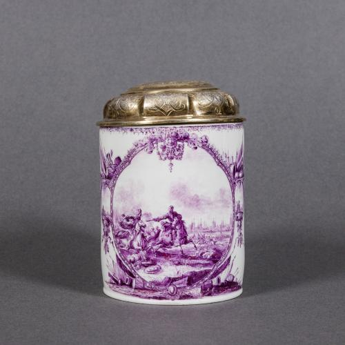 A rare small Meissen tankard painted in a purple camieu with an intricate continuous battle scene
