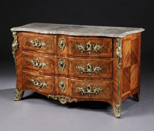 A French Louis XV Parquetry Commode with Gilt Bronze Mounts in the manner of François Garnier
