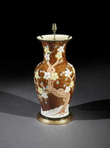 A Brown Ceramic Vase with Floral Vase
