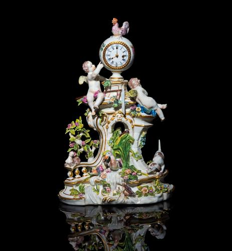 An important Chelsea clock-case with allegorical elements representing Dawn
