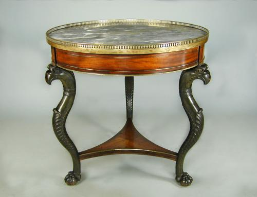 French Empire marble topped circular mahogany table with brass mounts and bronzed monopodia supports, c.1810
