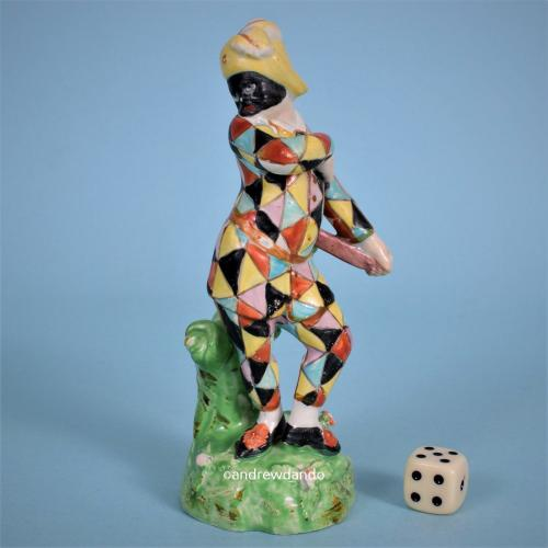 Staffordshire Figure of Harlequin, c1820.