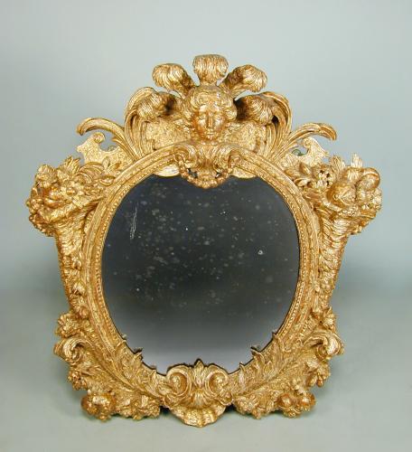 A George II period giltwood mirror of rare design, c.1730