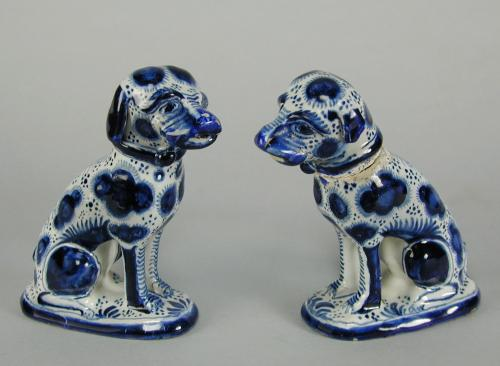 A very rare pair of English Delft models of dogs in blue and white, dated 1768