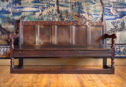 An Early Charles II Oak Panel Back Settle