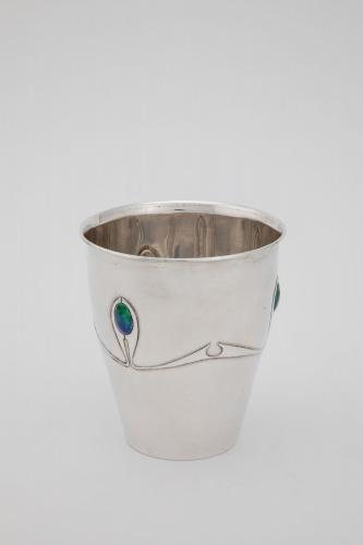 An Archibald Knox 'Cymric' Arts & Crafts silver & enamel beaker