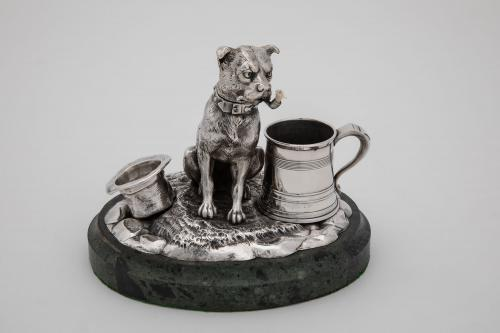 A Victorian anthropomorphic table cigar lighter, modelled as a seated terrier