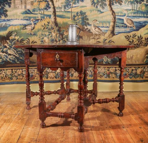 An Exceptional William and Mary Yew Wood Gateleg Table