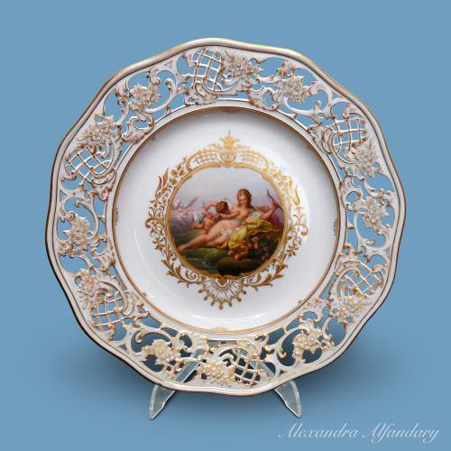 "A finely painted decorative Meissen plate, entitled ""Der besiegte Amor"""