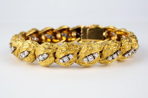 A heavy quality French 18 karat gold and brilliant cut diamond bracelet by Georland. Paris, circa.1965