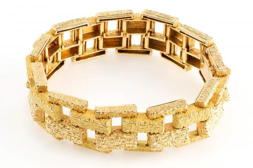 A heavy 18 karat gold bracelet of stippled brick design.  French, circa.1965