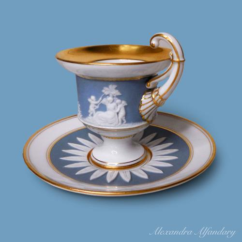 neo-classical Meissen chocolate cup and saucer with bisque applied decoration on Wedgewood blue ground