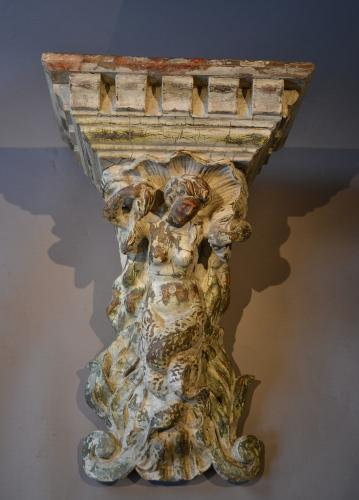 A large Georgian carved bracket in the form of a mermaid