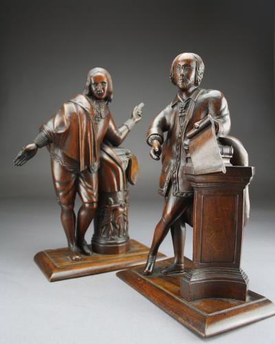A pair of English carved walnut figures of Shakespeare and Milton, early 19th century